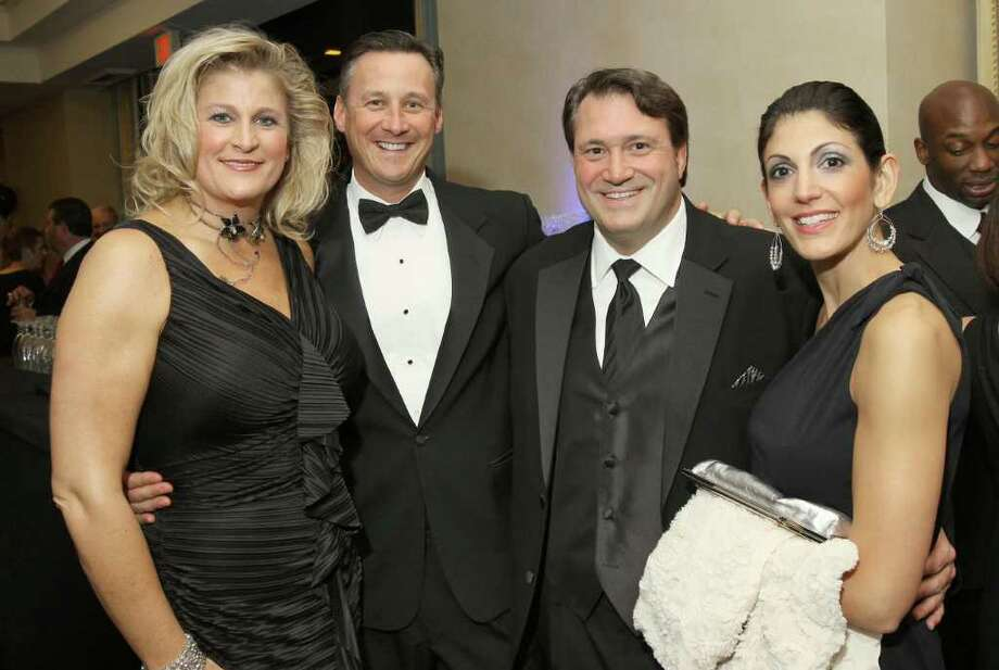 Albany, NY - November 12, 2011 - (Photo by Joe Putrock/Special to the Times Union) - (l to r) Kristin and Bill Hoblock and Brian and Marisa Akley during the 15th Annual Celestial Ball to benefit the Northeastern New York Chapter of the Juvenile Diabetes Research Foundation. Photo: Joe Putrock / Joe Putrock