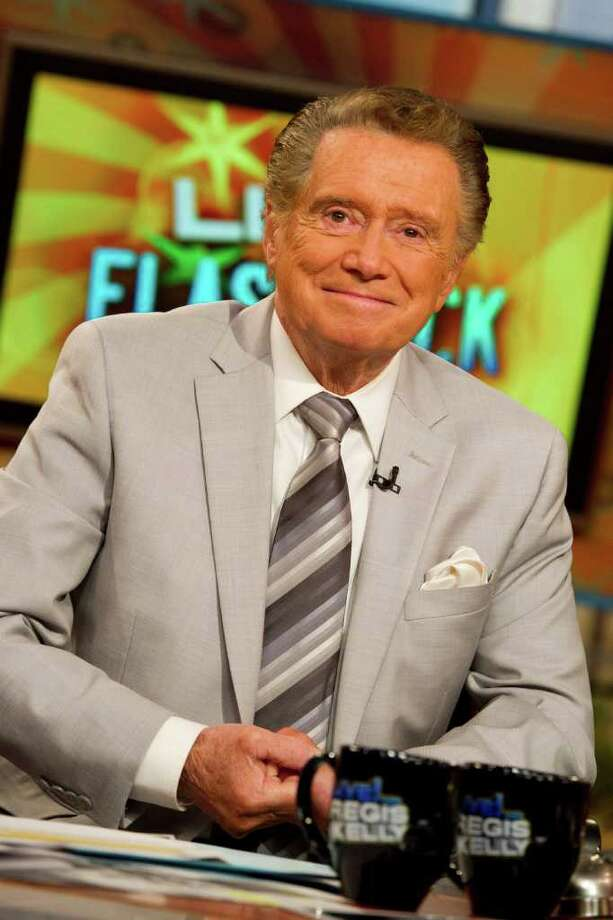 """FILE - In this Oct. 28, 2011 photo, long-time talk show host Regis Philbin appears on set during a broadcast of """"Live! with Regis and Kelly"""", in New York.  After ruling morning television for 28 years as New York's Everyman-about-town, the co-host who made performance art of TV gab is exiting what for a decade has been known as """"Live! With Regis and Kelly."""" His last day is Nov. 18. (AP Photo/Charles Sykes) Photo: Charles Sykes, Associated Press / AP2011"""