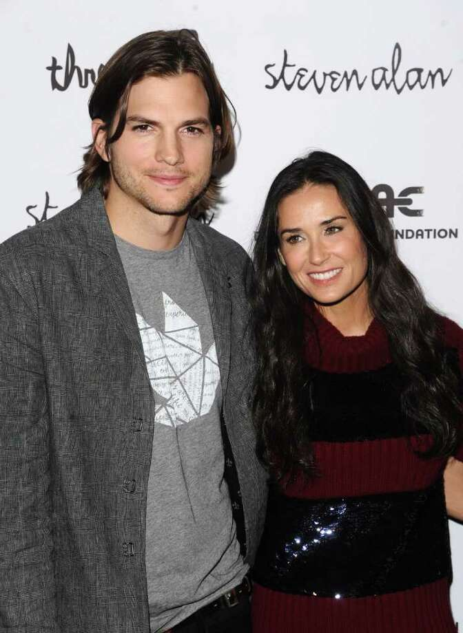 """FILE - In this April 14, 2011 file photo, Ashton Kutcher and Demi Moore attend the """"Real Men Don't Buy Girls"""" launch party, to raise awareness about child sex slavery, at the Steven Alan Annex in New York.  Moore is ending her marriage to Ashton Kutcher. The 49-year-old actress said Thursday, Nov. 17, 2011, that """"it is with great sadness and a heavy heart that I have decided to end my six-year marriage to Ashton."""" (AP Photo/Peter Kramer, file) Photo: Peter Kramer"""