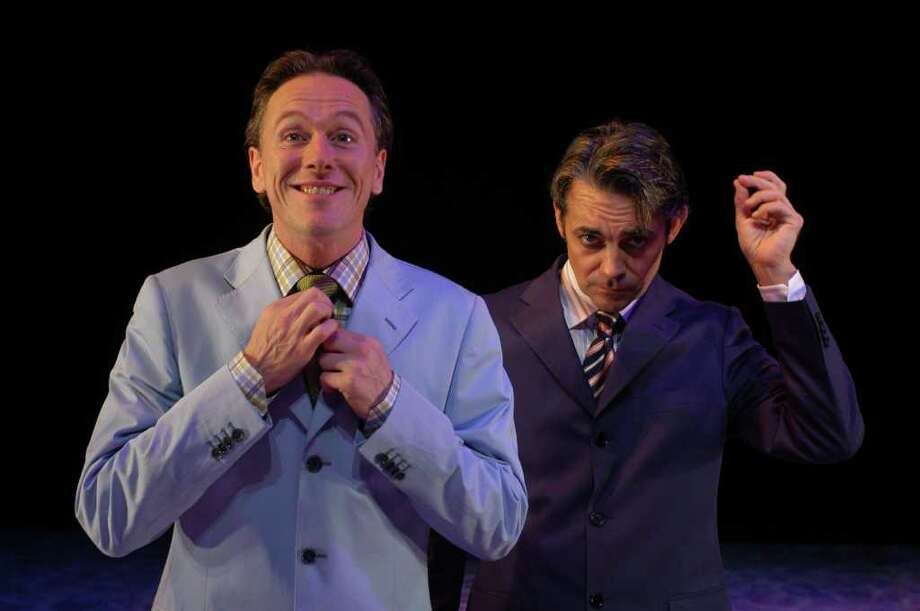 """Guy Oliver Watts, left, plays Algernon while Richard Willis portrays Jack Worthing in Aquila Theatre Co.'s production of Oscar Wilde's """"The Importance of Being Earnest."""" The company will perform the play Sunday, Nov. 20, at the Quick Center. Photo: Contributed Photo"""