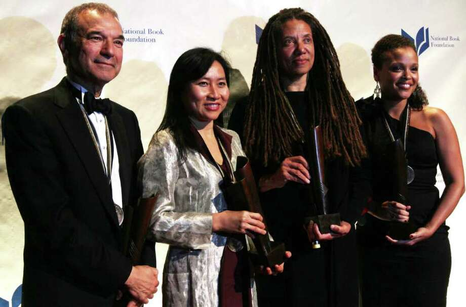 """National Book Award winners, from left, Stephen Greenblatt, for Nonfiction for his book """"The Swerve: How the World Became Modern"""", Thanhha Lai, for Young People's Literature for her book """"Inside Out & Back Again"""", Nikky Finney, for Poetry for her book """"Head Off & Split"""", and Jesmyn Ward, for Fiction for her book """"Salvage the Bones"""", hold their awards as they pose for photographs at the National Book Awards Wednesday Nov. 16, 2011 in New York.  (AP Photo/Tina Fineberg) Photo: Tina Fineberg"""