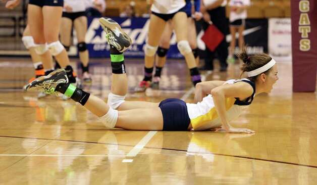 Poth's Micah Weaver (24) dives to the floor just missing a save on a point by Jewett Leon in 2A State semifinal volleyball in Strahan Coliseum at Texas State University in San Marcos on Thursday, Nov. 17, 2011. Poth defeated Leon in four games to move onto the state finals to be played on Saturday. Photo: Kin Man Hui, ~ / San Antonio Express-News