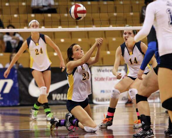 Poth's Tara Broyles (20) gets low to save a point against Jewett Leon in 2A State semifinal volleyball in Strahan Coliseum at Texas State University in San Marcos on Thursday, Nov. 17, 2011. Poth defeated Leon in four games to move onto the state finals to be played on Saturday. Photo: Kin Man Hui, ~ / San Antonio Express-News