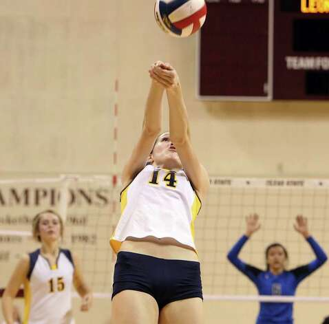 Poth's Kelsee Felux (14) returns a shot from the baseline against Jewett Leon in 2A State semifinal volleyball in Strahan Coliseum at Texas State University in San Marcos on Thursday, Nov. 17, 2011. Poth defeated Leon in four games to move onto the state finals to be played on Saturday. Photo: Kin Man Hui, ~ / San Antonio Express-News