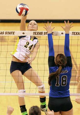 Poth's Micah Weaver (24) attempts a shot against Jewett Leon's Amy Holt (18) in 2A State semifinal volleyball in Strahan Coliseum at Texas State University in San Marcos on Thursday, Nov. 17, 2011. Poth defeated Leon in four games to move onto the state finals to be played on Saturday. Photo: Kin Man Hui, San Antonio Express-News / San Antonio Express-News