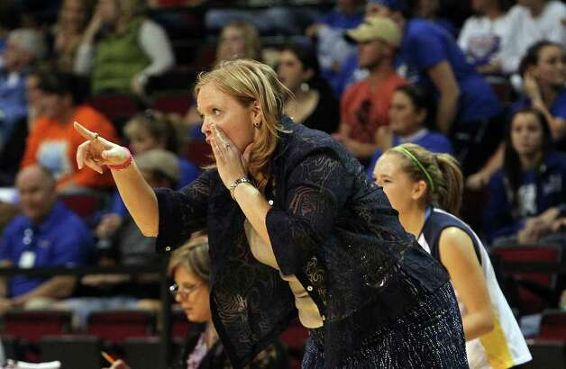 Poth volleyball coach Patti Zenner directs her team against Jewett Leon in 2A State semifinal volleyball in Strahan Coliseum at Texas State University in San Marcos on Thursday, Nov. 17, 2011. Poth defeated Leon in four games to move onto the state finals to be played on Saturday. Photo: Kin Man Hui, ~ / San Antonio Express-News