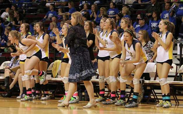 The Poth bench erupts after a team score against Jewett Leon in 2A State semifinal volleyball in Strahan Coliseum at Texas State University in San Marcos on Thursday, Nov. 17, 2011. Poth defeated Leon in four games to move onto the state finals to be played on Saturday. Kin Man Hui/kmhui@express-news.net Photo: Kin Man Hui, SAN ANTONIO EXPRESS-NEWS / San Antonio Express-News