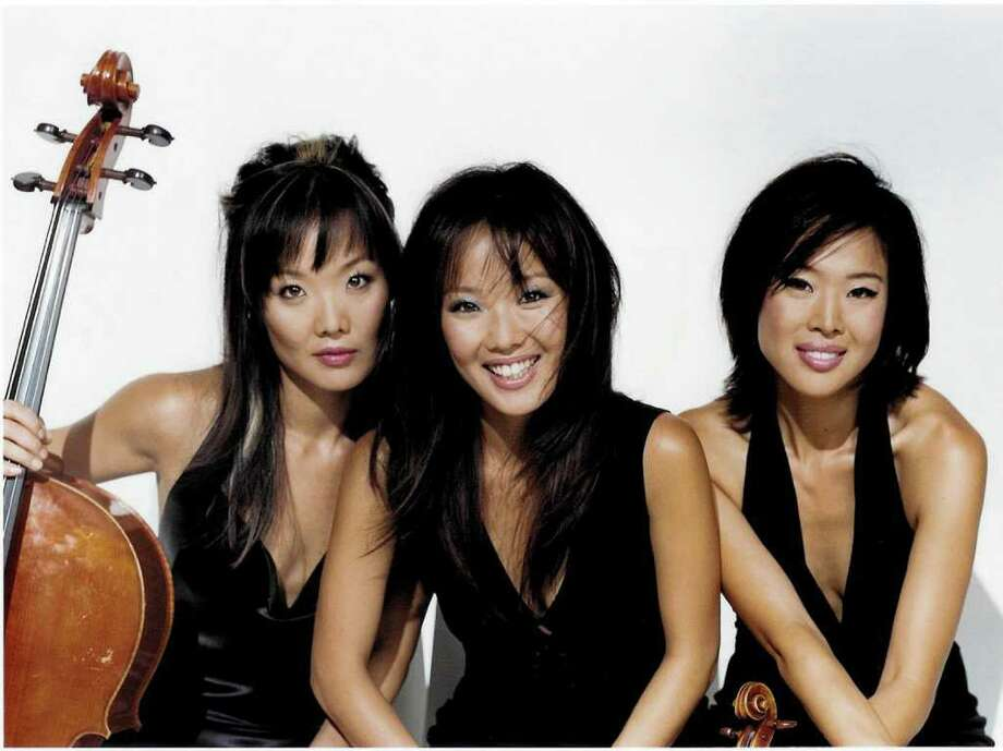 The Ahn Trio, comprised of sisters Maria on cello, Lucia on piano and Angella on violin, will perform Dec. 4 at the Quick Center. Photo: Contributed Photo