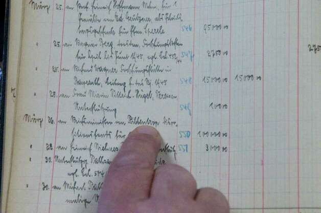 An entry in a ledger book kept by Hitler's staff of the Fuhrer's expenses shows a payment to Joachim von Ribbentrop for food and other provisions. Alexander's Autograph will auction off the ledger and other World War II artifacts including Adolf Hitler's desk set which was used to sign the 1938 Munich Pact between France, England, Italy and Germany that allowed Hitler to annex the Sudetenland in Czechoslovakia, a moment of infamy in European history. Also for sale are various post World War II documents showing collusion between various officials to help Nazis escape central Europe. various officials to help Nazis escape central Europe. Photo: Keelin Daly / Stamford Advocate