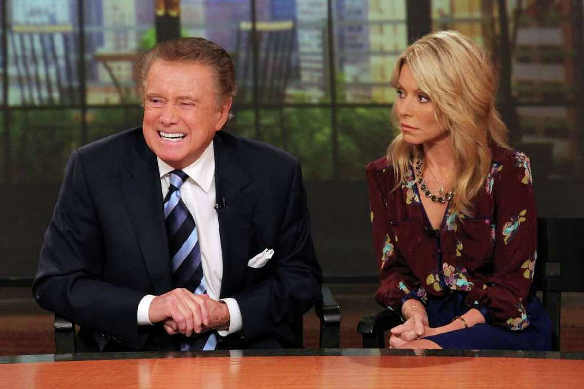 """NEW YORK, NY - NOVEMBER 17: Regis Philbin and Kelly Ripa attend a press conference on Regis's departure from """"LIVE! with Regis and Kelly"""" at ABC Studios on November 17, 2011 in New York City. (Photo by Rob Kim/Getty Images)"""