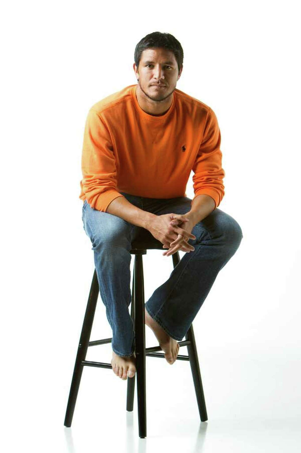 Houston Dynamo forward Brian Ching poses for a portrait in the Chronicle Studio Tuesday, Nov. 8, 2011, in Houston. Ching is shown wearing Polo by RL orange top, $125; Neiman Marcus. ( Brett Coomer / Houston Chronicle )
