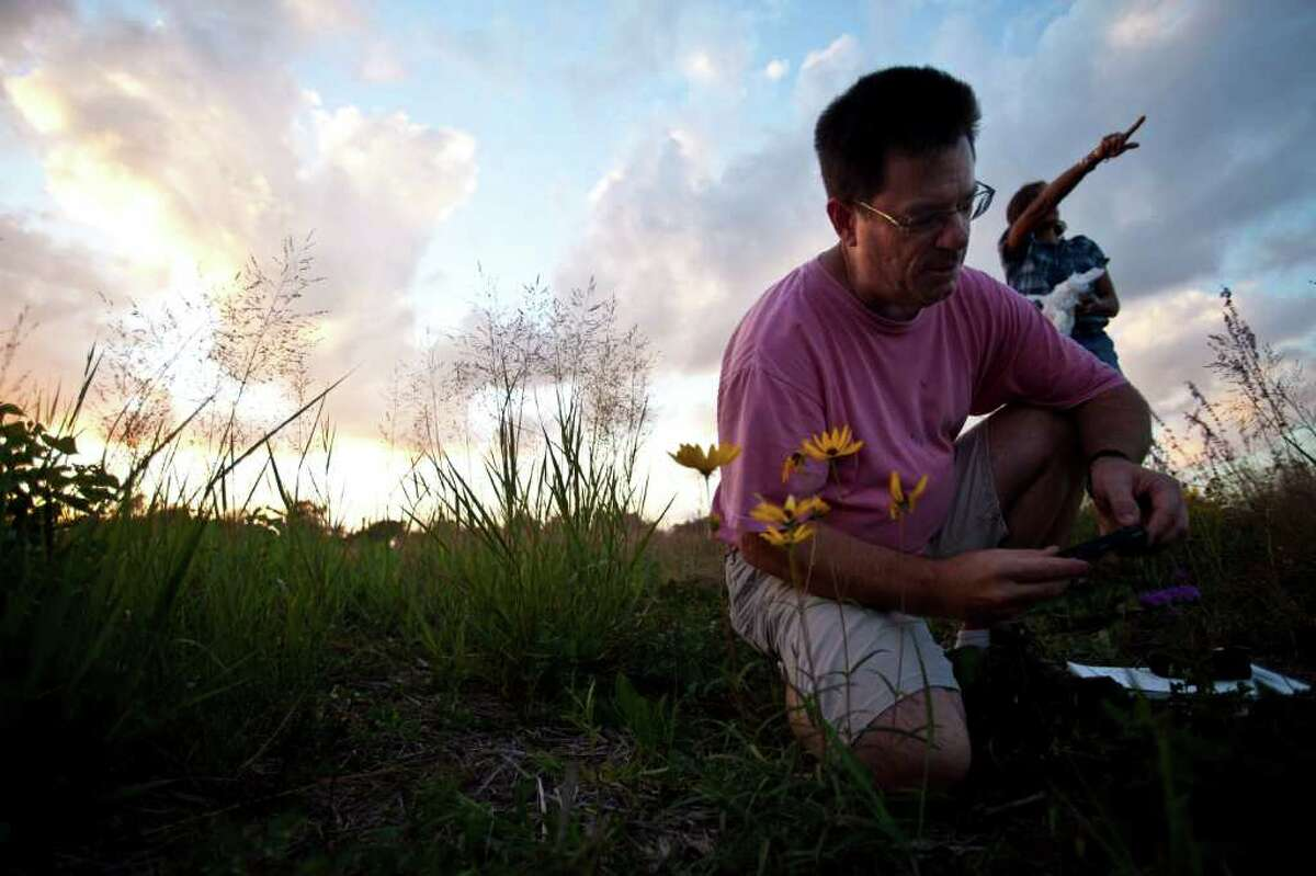 GETTING DIRTY: Chris Gray was one of several enthusiasts who investigated the prairie.