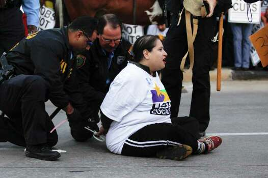 Members of Occupy Houston are arrested after sitting in the middle of Travis Street to block the North Freeway on-ramp after a march through downtown Houston Nov. 17, 2011. Photo: Eric Kayne, For The Chronicle / © 2011 Eric Kayne