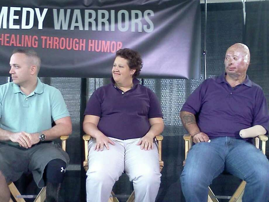 "From left to right, three injured veterans of the war in Iraq - Stephen Rice of Annapolis, Md., Darisse Smith of Charlotte, N.C., and Bobby Henline of San Antonio, Texas, talk about their role in the documentary ""Comedy Warriors"" Thursday in the Albany International Airport. (Photo by Dennis Yusko)"