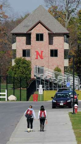 Students walk to Niskayuna High School, where the FBI has joined an investigation into online threats made against the school's students and the police, on Wednesday Nov. 2, 2011 in Niskayuna, NY.  (Philip Kamrass / Times Union ) Photo: Philip Kamrass / 00015257A