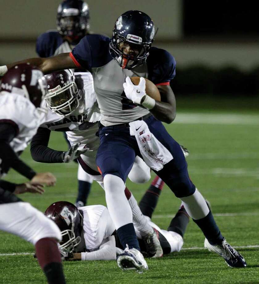 Dawson High School James White carries the ball against Reagan High School during the second quarter of football game at Galena Park ISD Stadium Thursday, Nov. 17, 2011, in Houston. Photo: Melissa Phillip, Houston Chronicle / © 2011 Houston Chronicle