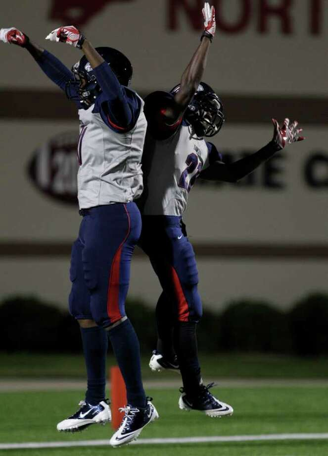 Nov. 17: Dawson 72, Reagan 7 Dawson High School  Tony Upchurch, left, and Matthew Bogues, right,  celebrate Bogues' touchdown. Photo: Melissa Phillip, Houston Chronicle / © 2011 Houston Chronicle