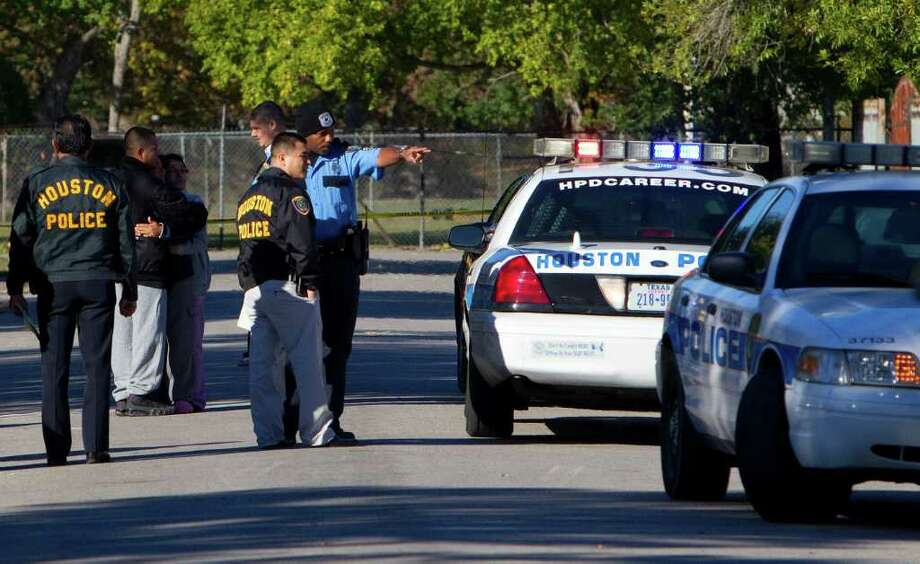 Police probe the reported home invasion in the 1100 block of Hartwick near Bauman in north Houston early Thursday. Photo: Cody Duty / © 2011 Houston Chronicle
