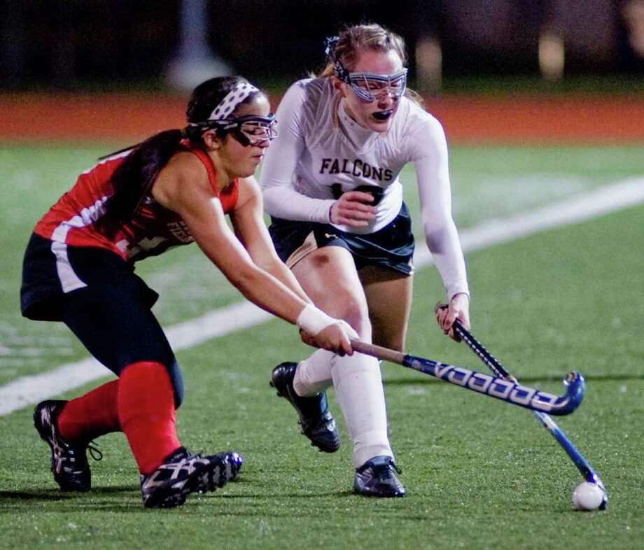 Branford's Erica McLean, left, and Barlow's Gabrielle Fignar fight for the ball in the Class M state semifinals played at Fairfield Ludlowe High School. Thursday, Nov. 17, 2011 Photo: Scott Mullin / The News-Times Freelance
