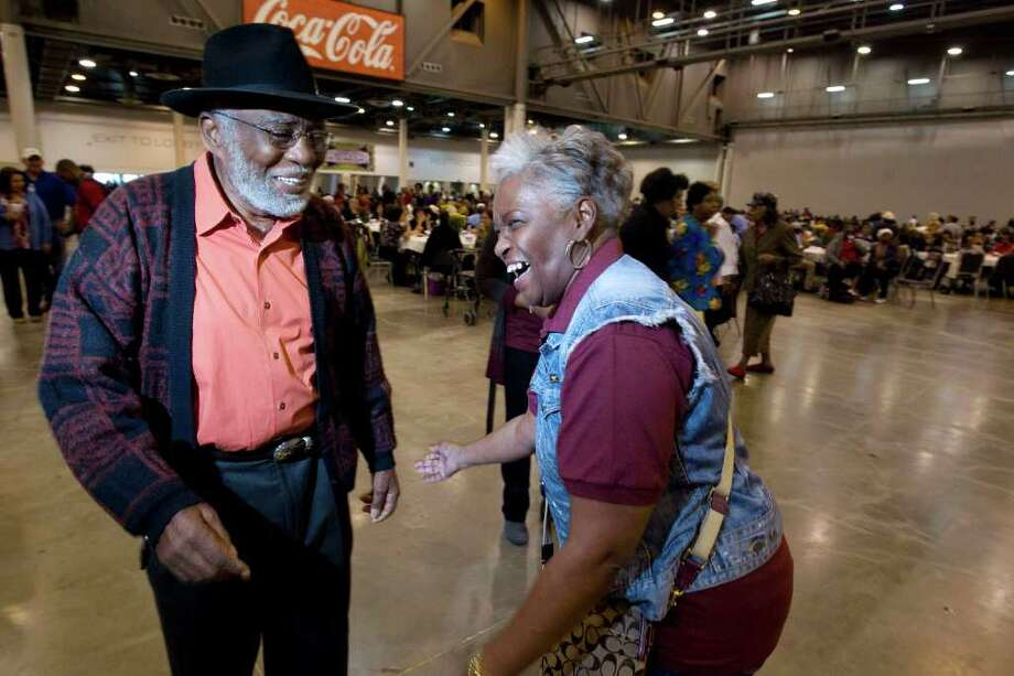 Carol Dickerson, 58, and Billy Mitchell, 75, dance as they joined about 3500 senior citizens during the Precinct One Harris County Commissioner El Franco Lee's 19th Annual Seniors Holiday Celebration at Reliant Center Thursday, Nov. 17, 2011, in Houston. Photo: Johnny Hanson, Houston Chronicle / © 2011 Houston Chronicle