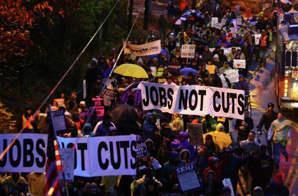 Protesters march to the University Bridge in Seattle during an Occupy Seattle and labor union rally.