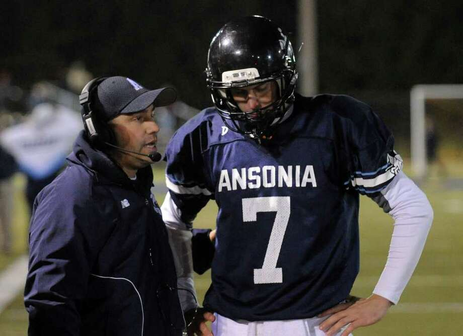 Highlights from NVL Chapionship football action between Holy Cross and Ansonia in Waterbury, Conn. on Thursday November 17, 2011. Head Coach Thomas Brockett with QB Elliot Chudwick. Photo: Christian Abraham / Connecticut Post
