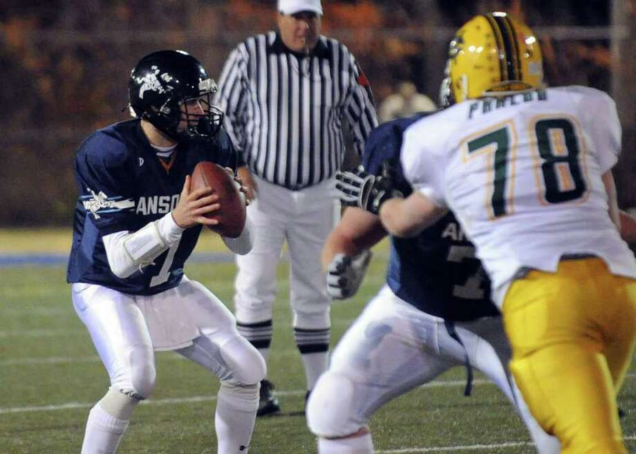 Highlights from NVL Chapionship football action between Holy Cross and Ansonia in Waterbury, Conn. on Thursday November 17, 2011. Ansonia QB Elliot Chudwick. Photo: Christian Abraham / Connecticut Post