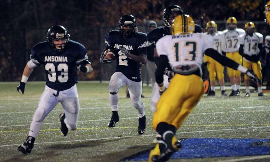 Highlights from NVL Chapionship football action between Holy Cross and Ansonia in Waterbury, Conn. on Thursday November 17, 2011. Ansonia's #2 Arkeel Newsome, center, carries the ball. Photo: Christian Abraham / Connecticut Post