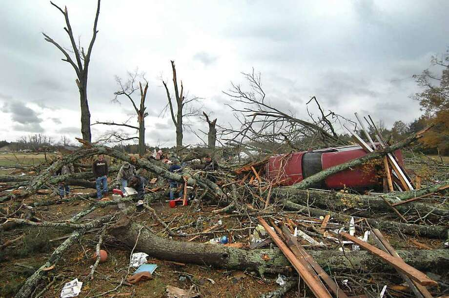 Residents sort through the remnants of a house on S.C. 324 near Williamson Rd. in Rock Hill, SC Thursday, Nov. 17, 2011. A tornado-spawning storm system passed through the Southeast Wednesday, flattening homes and killing at least six people in three states. Photo: Todd Sumlin, Associated Press / THE CHARLOTTE OBSERVER