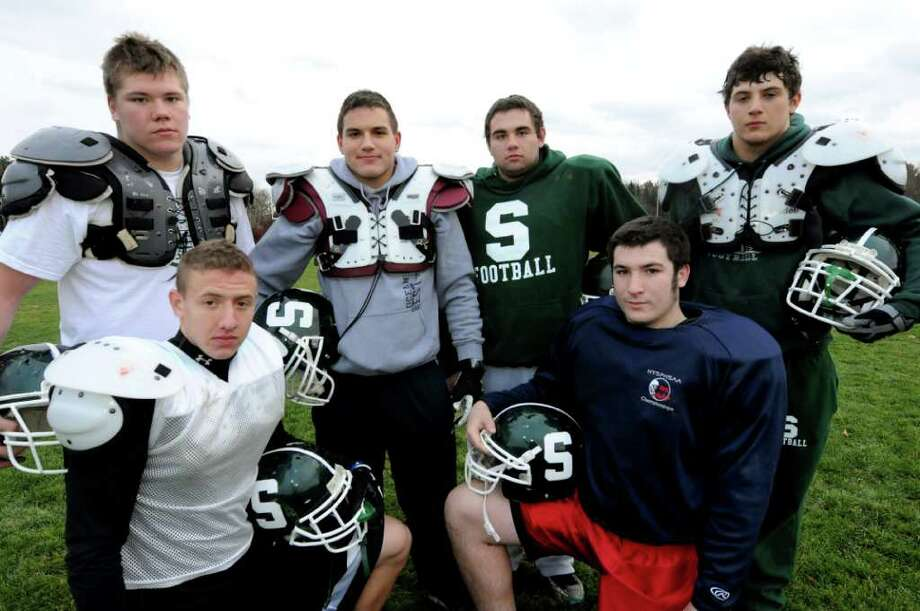 Schalmont football team's offensive line on Thursday, Nov. 17, 2011, at Schalmont High in Rotterdam, N.Y. Clockwise from lower left is Pete Kalil, Mike Famalaro, Jesse Ross, Tyler Mattick, Brian Pomykai and Marcus Ramundo. (Cindy Schultz / Times Union) Photo: Cindy Schultz / 00015449A