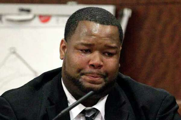 Suspended Green Bay Packers defensive lineman Johnny Jolly cries as he testifies in court Thursday, Nov. 17, 2011, in Houston. Jolly was sentenced to six years in prison for violating the terms of his probation on a drug charge.