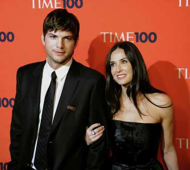 "(FILES): This May 4, 2010 file photo shows actors Ashton Kutcher and Demi Moore attending Time's 100 Most Influential People at Frederick P. Rose Hall, Jazz at Lincoln Center in New York. Demi Moore announced ""with sadness"" on Thursday, November 17, 2011 the end of her high-profile marriage to Ashton Kutcher, after his reported infidelity with a woman less than half her age. The confirmation comes after months of media reports about problems between the couple, who married in 2005 when she was 42 and he was 27. She had earlier been married to actor Bruce Willis for 13 years.     AFP PHOTO / Files / TIMOTHY A. CLARY (Photo credit should read TIMOTHY A. CLARY/AFP/Getty Images) Photo: TIMOTHY A. CLARY / AFP"