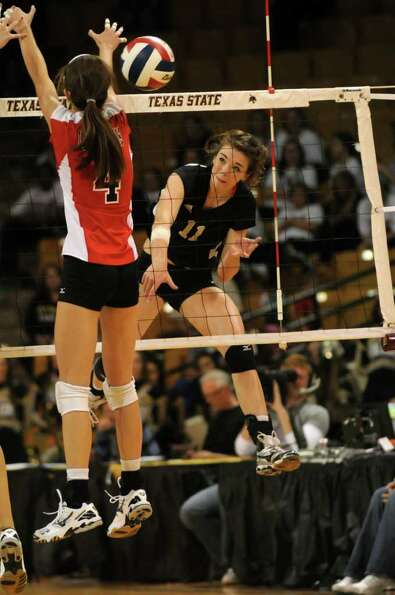 Richmond Foster senior Kelsey Alford (11) sends one of her team-high 12 kills past Lake Travis senio