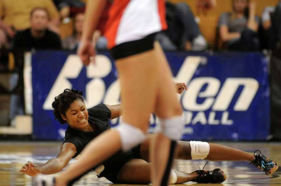 Nov. 17: Lake Travis 3, Foster 1Richmond Foster senior Tina Dockery junior Megan Haas goes down for a dig  against Lake Travis. Foster fell in the Class 4A state semifinals. Photo: Jerry Baker, For The Chronicle