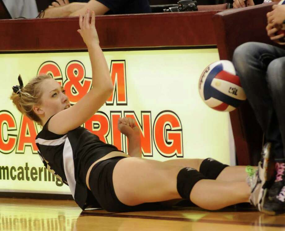 Richmond Foster junior Megan Haas goes all out on a dig attempt. Photo: Jerry Baker, For The Chronicle