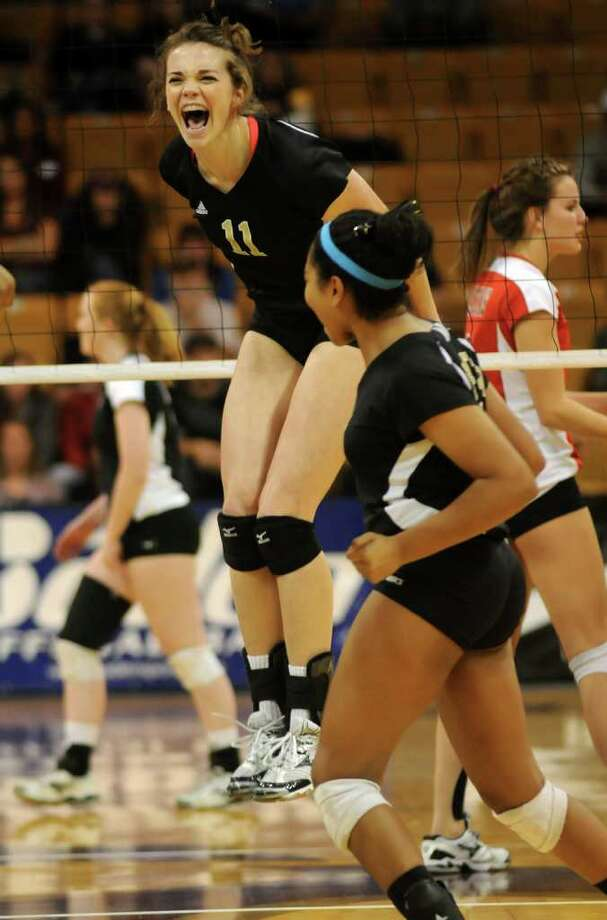 Richmond Foster senior Kelsey Alford (#11) celebrates a point against Lake Travis. Photo: Jerry Baker, For The Chronicle