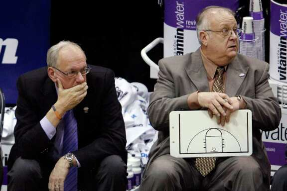 "FILE - In this March 25, 2010, file photo, Syracuse coach Jim Boeheim, left, and assistant coach Bernie Fine sit on the bench at the end an NCAA West Regional semifinal college basketball game against Butler in Salt Lake City. Syracuse has placed longtime assistant basketball coach Fine on administrative leave ""in light of the new allegations and the Syracuse City Police investigation."" (AP Photo/Steve C. Wilson, File)"