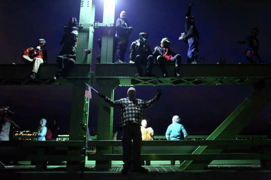 Protesters climb on the University Bridge in Seattle during an Occupy Seattle and labor union protest. Occupy Seattle protesters and labor union members gathered on the bridge to call for the government to spend more money on infrastructure. The protesters shut down the Seattle bridge during rush hour. Photo: JOSHUA TRUJILLO / SEATTLEPI.COM