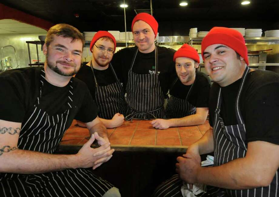 Chef Jason Baker, left, and Chef de Cusine Richard Torino, right, with their brigade on Tuesday, Nov. 15, 2011, at Capital City Gastropub in Albany, N.Y. The brigade, in the center from left, are Patrick McNally, Daniel McBain and Sean Mitchell. (Cindy Schultz / Times Union) Photo: Cindy Schultz /  00015386A