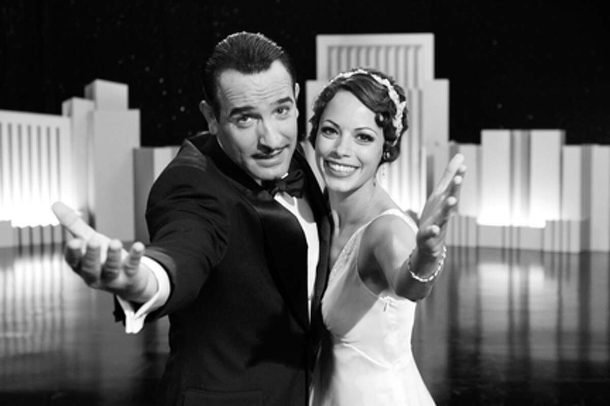 Jean Dujardin as George Valentin and Bérénice Bejo as Peppy Miller in