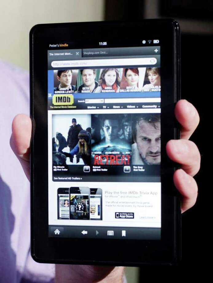 FILE - This file photograph taken Sept. 28, 2011, shows the Kindle Fire at a news conference, in New York. Research firm IHS said the Amazon.com Inc.'s Kindle Fire tablet, which started shipping this week, costs $201.70 to make, $2.70 more than Amazon charges for it. (AP Photo/Mark Lennihan, File) Photo: Mark Lennihan / AP2011