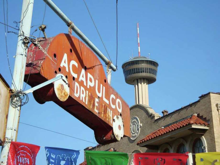 A photo of the famous old car sign that used to hang in front of the Acapulco Drive Inn. Photo: Courtesy Photo