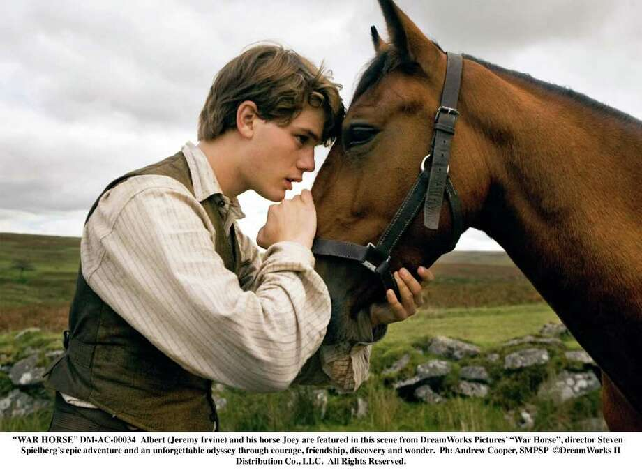 """WAR HORSE""  DM-AC-00034  Albert (Jeremy Irvine) and his horse Joey are featured in this scene from DreamWorks Pictures' ""War Horse"", director Steven Spielberg's epic adventure and an unforgettable odyssey through courage, friendship, discovery and wonder.  Ph: Andrew Cooper, SMPSP  DreamWorks II Distribution Co., LLC.  All Rights Reserved. Photo: Andrew Cooper, SMPSP / ©DreamWorks II Distribution Co., LLC.  All Rights Reserved."