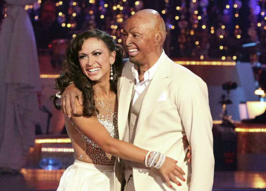 ADAM TAYLOR : ABC dancing with the stars: Who will win the coveted disco ball trophy: Ricki Lake, J.R. Martinez (above, with dance partner Karina Smirnoff) or Rob Kardashian? Final performances at 7 p.m. Monday; results at 8 p.m. Tuesday on ABC. Photo: Adam Taylor / © 2011 American Broadcasting Companies, Inc. All rights reserved.