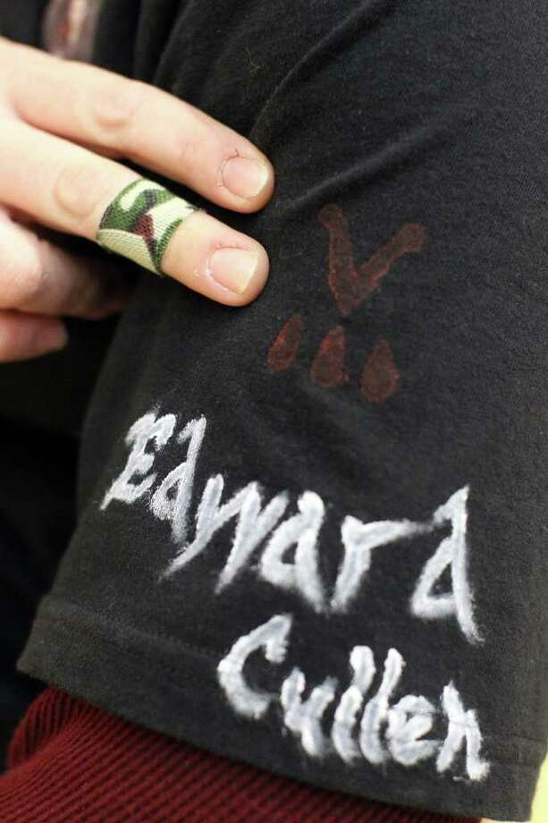 Erika Wert shows off Edward's name on the sleeve of her homemade Twilight t-shirt as she waits to see an opening midnight showing of Twilight Breaking Dawn at the Palladium Theatre at The RIM, Thursday, November 17, 2011. Photo: Jennifer Whitney, Jennifer Whitney/ Special To The Express-News / Jennifer Whitney/special to the Express-News