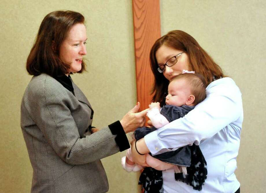 Danbury Probate Judge Dianne Yamin, left, talks with Monica Bevilacqua her 10-week-old daughter, Serena, before Yamin addresses Danbury's Promise for Children Partnership Leadership team meeting Friday, Nov. 18, 2011. Monica Bevilacqua is Brookfield's Head Start director. Photo: Michael Duffy / The News-Times