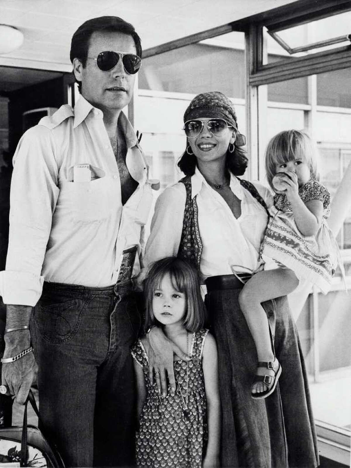 American actress Natalie Wood (1938-1981), her children Natasha (C), Courtney (R), and her husband actor Robert Wagner arrive at London airport July 4, 1976. She was married three times, twice to Wagner.
