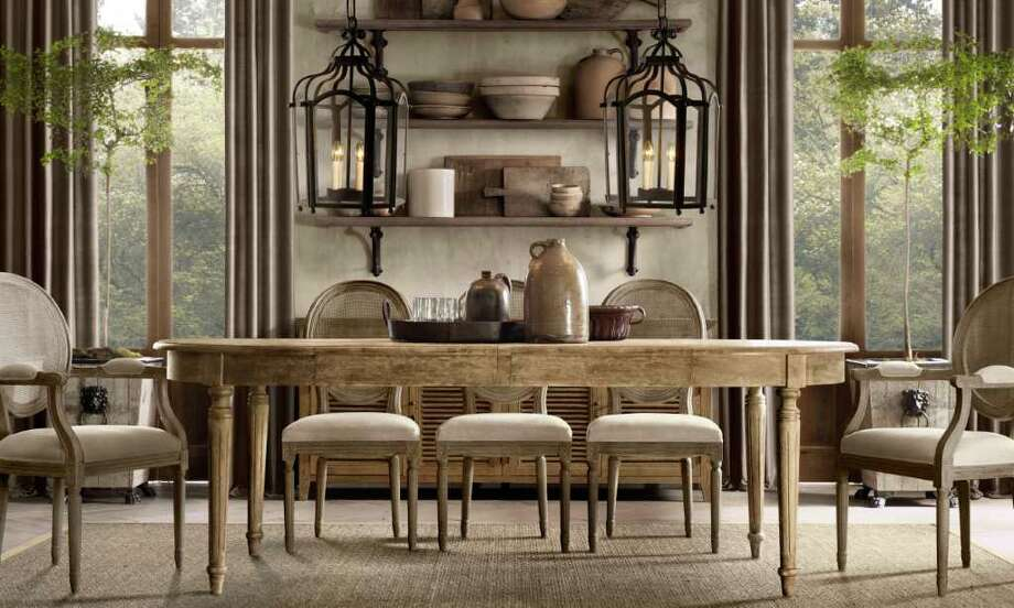 Hanging two pendants over a long table creates drama in the dining room.