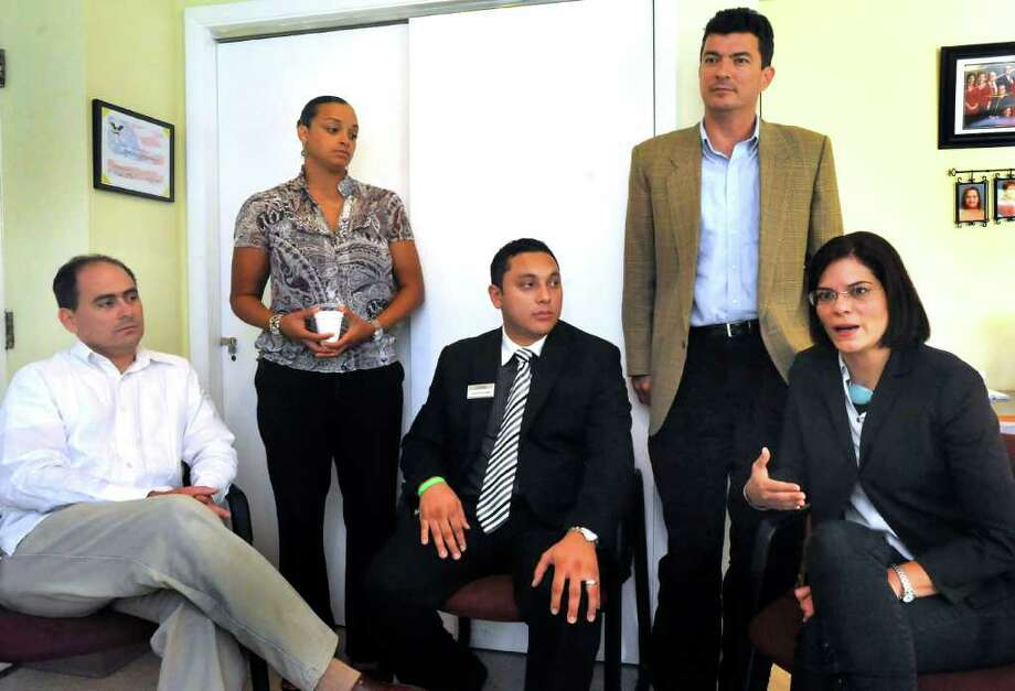 Hispanic leaders talk to The News-Times in September 2011. Pictured from left are, Camilo Fadul, president of the board of directors of the Greater Danbury Hispanic Center; Shirley Ricart, executive director of WeCAHR; Carlos Valenzuela, mortgage originator of Union Savings Bank and board member of the Latino Scholarship Fund; Nelson Merchan, president of CLICROI, LLC and business councelor with SCORE; and Ingrid Alvarez-DiNarzo, executive director of the Hispanic Center of Greater Danbury. Photo: Michael Duffy