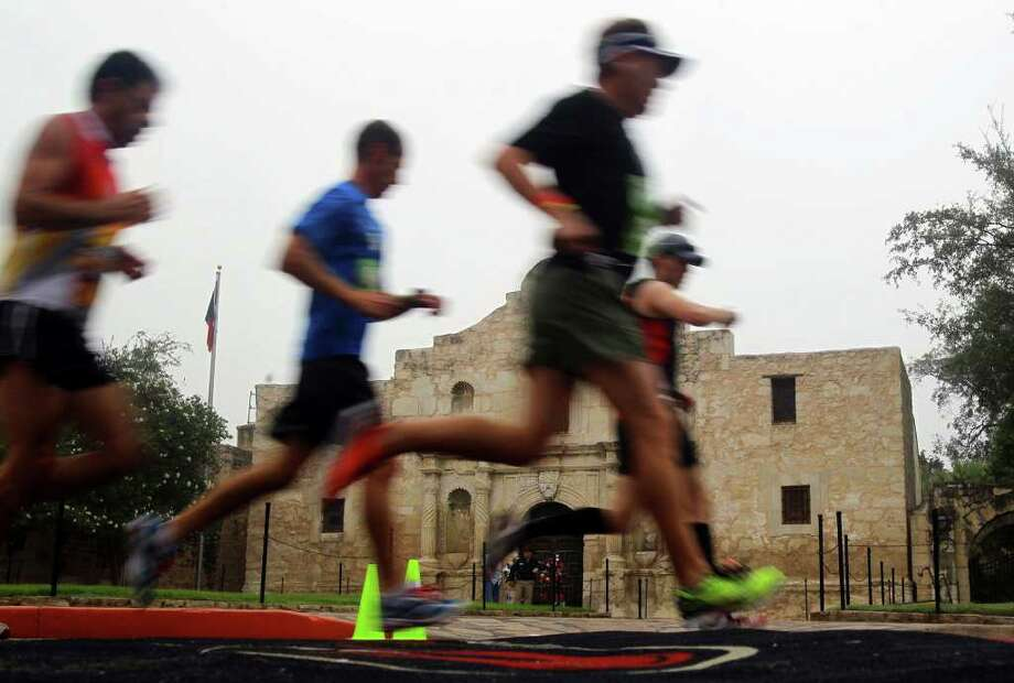 Runners in the Rock 'n' Roll San Antonio Marathon & 1/2 pass the Alamo Sunday November 13, 2011. Photo: JOHN DAVENPORT, Express-News / SAN ANTONIO EXPRESS-NEWS (Photo can be sold to the public)